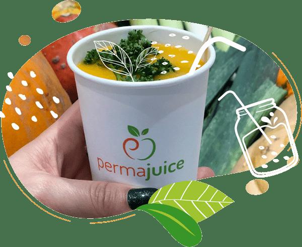 Cette photo de gobelet compostable contient une soupe avec un topping de persil frais
